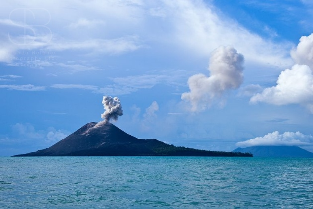 Krakatoa Volcano, Anak Krakatoa, Krakatau, Sunda Strait, Ujung Kulon National Park , Indonesia, horizontal, day, sea, ocean,water, blue, clouds, smoke, steam,