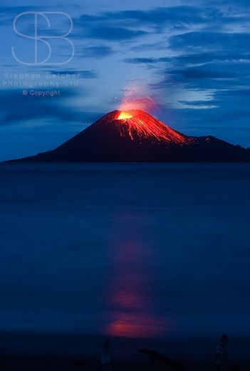 Krakatoa Volcano, Anak Krakatoa, Krakatau, Sunda Strait, Ujung Kulon National Park , Indonesia, vertical, dusk, clouds, ocean, sea, water, reflection, red, orange, blue, lava, erupting, flowing, hot