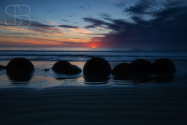 Dawn, Moeraki Boulders, Koekohe Beach, Otago, New Zealand, horizontal, horizon, sunrise, sea, ocean, water, sand, ripples, cloud, blue, orange, silhouette