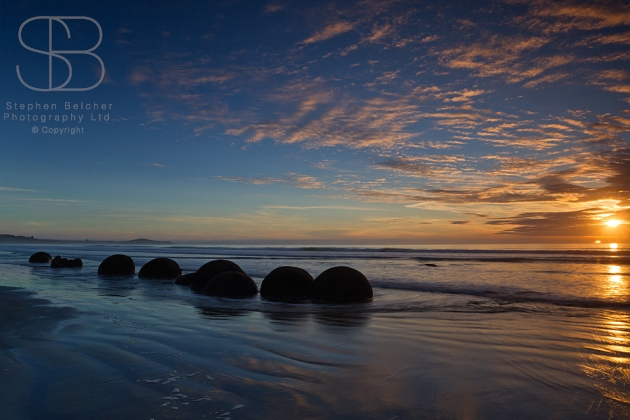 Dawn, Moeraki Boulders, Koekohe Beach, Otago, New Zealand, horizontal, sunrise, blue, orange, yellow, sea, water, ocean, reflection, cloud, no people, ripples, tranquil