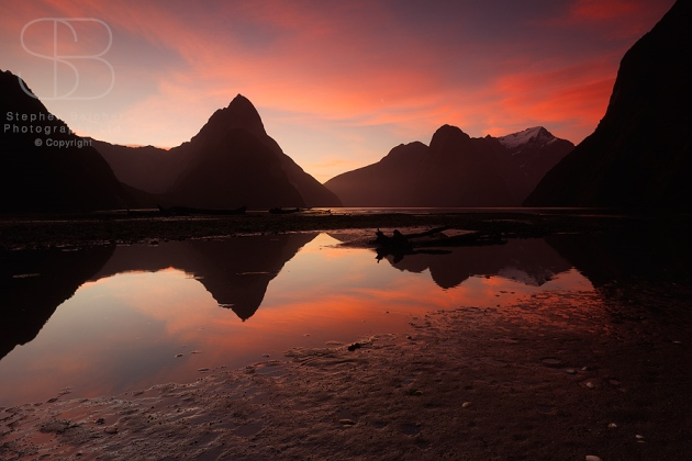 Mitre Peak, Sunset,  Milford Sound, Fiordland National Park, New Zealand, horizontal, reflection, orange, pink, red, water, still, glass, mirror, tranquil, sky, no people