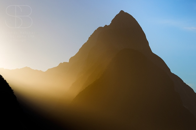 Mitre Peak, Milford Sound, Fiordland National Park, New Zealand, sunrise, silhouette, orange, yellow, mist, haze, no people
